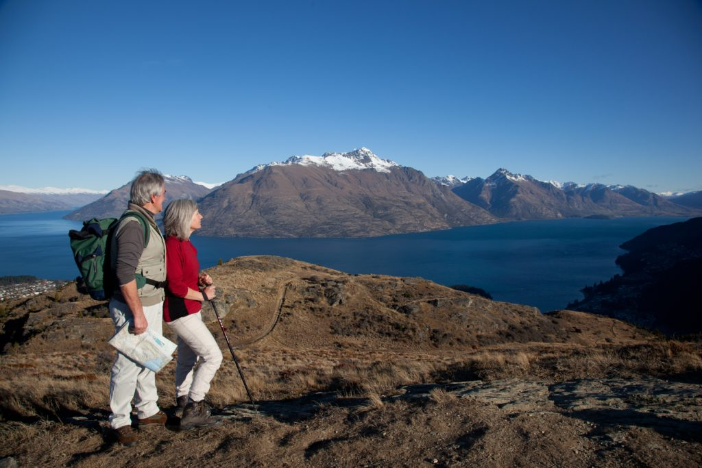 Couple on scenic Queenstown Hill hike, one of the best walks in Queenstown