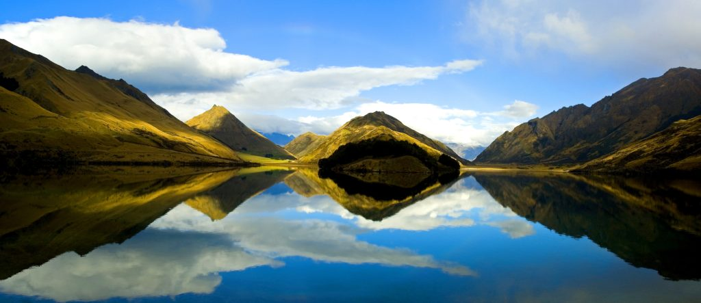 Moke Lake in Queenstown with reflections of the surrounding mountains is a beautiful day hike and wedding spot for photos